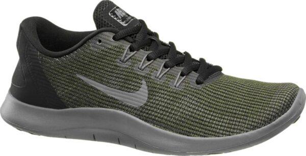 Der Fitnessschuh von Nike ist schlank aber bequem geschnitten und aus grünem Mesh gefertigt Für Halt und Stabilität sorgt die mit einem schwarzen Synthetik Einsatz verstärkte Ferse Innen ist der Schuh mit atmungsaktivem Mesh und Textil versehen – so bietet er auch bei intensiver sportlicher Betätigung ein gesundes Fußklima Graue Label Details runden das Design ab