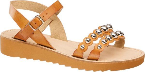 In einem dezenten Cognac präsentiert sich die Sandale von Graceland Der Look der Sandale wird ergänzt durch den silbernen Perlenbesatz auf den vorderen Riemen der dem Schuh seine stilvolle Eleganz verleiht Der Keilabsatz des Schuhs hat dabei eine angenehme Absatzhöhe von 3 2 cm So ist die Sandale die ideale Wahl für den Alltag Spaziergänge oder auch zur Ergänzung von extravaganten Frühlings und Sommeroutfits